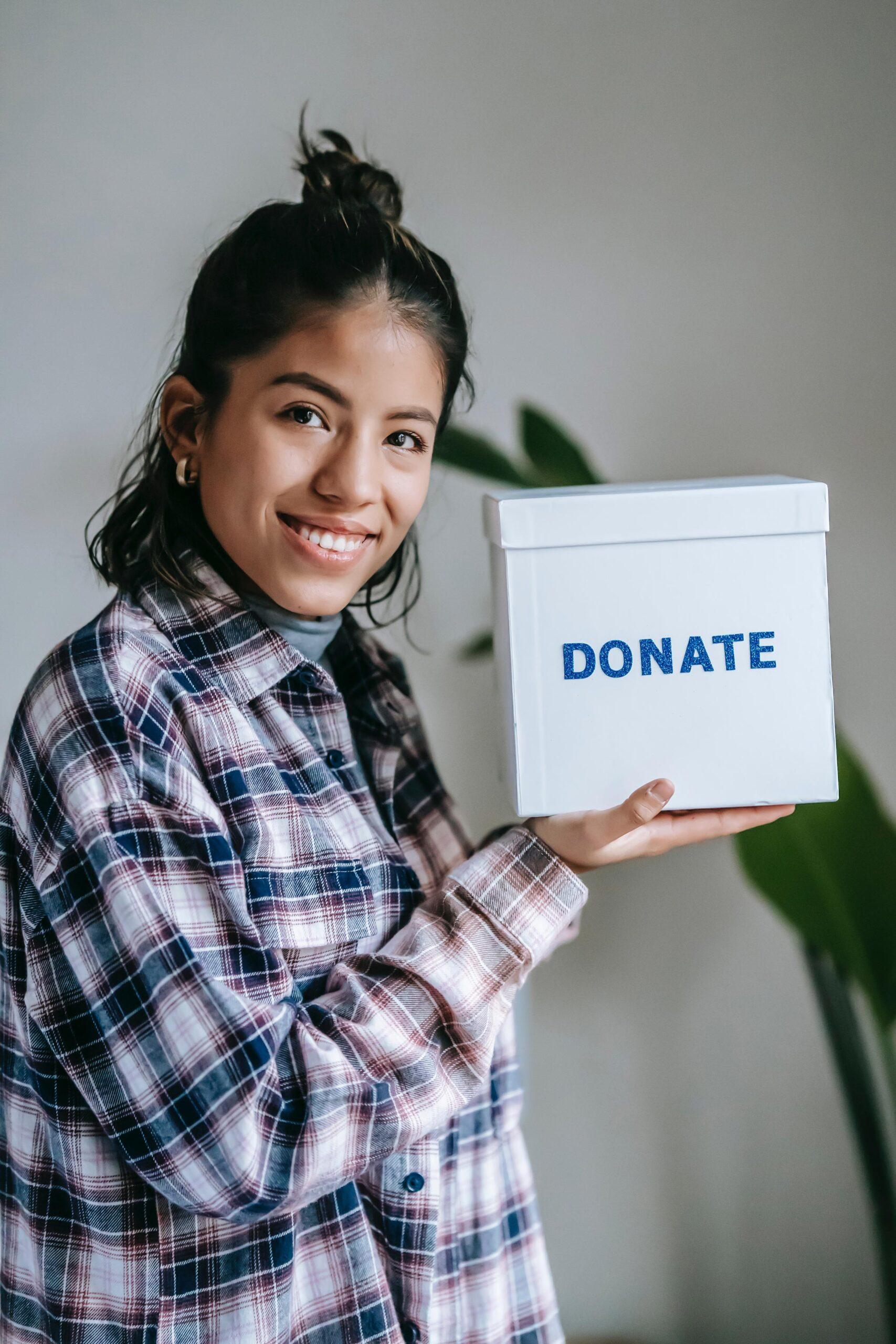 Girl showing donate box