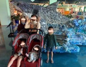 This is a picture of a family including foster children during a visit to The Florida Aquarium in Tampa